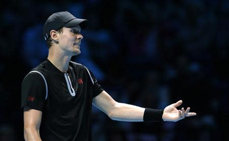 Tomas Berdych of the Czech Republic disputes a line judge's call during his men's singles tennis match against Stanislas Wawrinka of Switzerland at the ATP World Tour Finals at the O2 Arena in London November 4, 2013. REUTERS/Suzanne Plunkett
