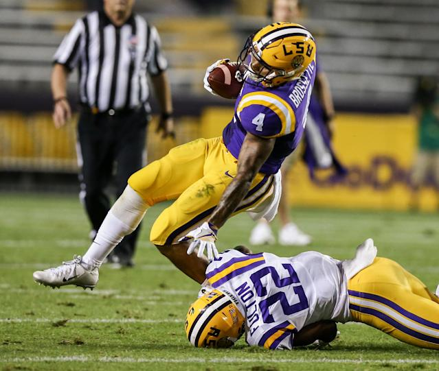 "LSU defensive back <a class=""link rapid-noclick-resp"" href=""/ncaaf/players/263412/"" data-ylk=""slk:Kristian Fulton"">Kristian Fulton</a> (22) makes a low tackle on running back Nick Brossette (4) during the annual purple-gold spring game on April 22, 2017. (Photo by Stephen Lew/Icon Sportswire via Getty Images)"