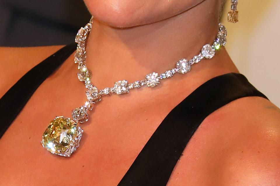 Lady Gaga 's Tiffany Yellow Diamond necklace during the 2019 Vanity Fair Oscar Party hosted by Radhika Jones at Wallis Annenberg Center for the Performing Arts on February 24, 2019 in Beverly Hills, California. (Photo by Tony Barson/FilmMagic)