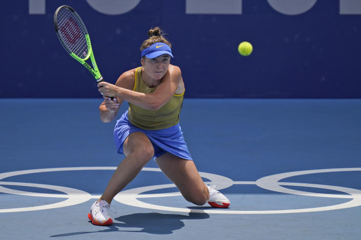 Elina Svitolina, of the Ukraine, plays Camila Giorgi, of Italy, during the quarterfinals of the tennis competition at the 2020 Summer Olympics, Wednesday, July 28, 2021, in Tokyo, Japan. (AP Photo/Seth Wenig)