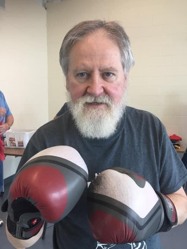 Dr. Harry Robertson says he feels better when he fights back against Parkinson's disease with exercises like boxing.