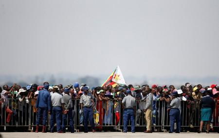 Zimbabweans wait for the arrival of the body of former Zimbabwean President Robert Mugabe to the country after he died on Friday (September 6) in Singapore after a long illness