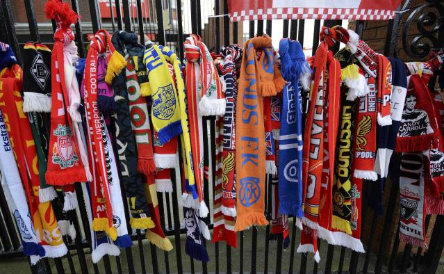 Scarves are tied to a gate by the Hillsborough memorial ahead the English Premier League soccer match between Liverpool and Manchester City at Anfield in Liverpool, northern England April 13, 2014. REUTERS/Nigel Roddis (BRITAIN - Tags: SPORT SOCCER)