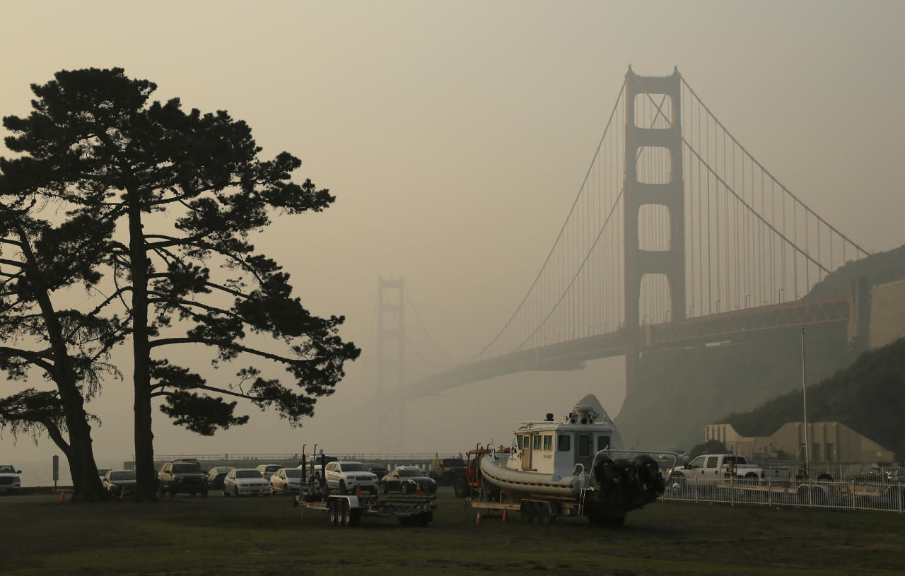 The Golden Gate Bridge is obscured by smoke and haze from wildfires Friday, Nov. 16, 2018, in this view from Fort Baker near Sausalito, Calif. (AP Photo/Eric Risberg)