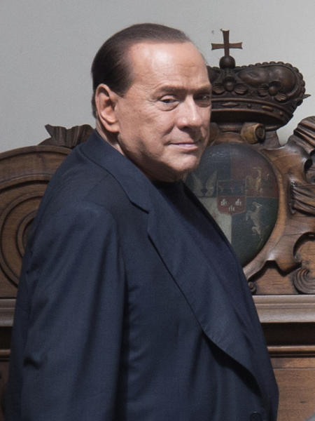 FILE - In this Thursday, Sept. 19, 2013 file photo, former Italian Premier Silvio Berlusconi arrives in his private residence, in Rome. Government ministers in former Premier Silvio Berlusconi's political party have announced Saturday, Sept. 28, 2013 their intention to resign their posts, a move that raises tension in the uneasy coalition government and increases the possibility of early elections. Vice Premier Angelino Alfano's spokeswoman said Saturday the five ministers from Berlusconi's center-right People of Freedom Party have decided to submit their resignations. (AP Photo/Andrew Medichini, Files)