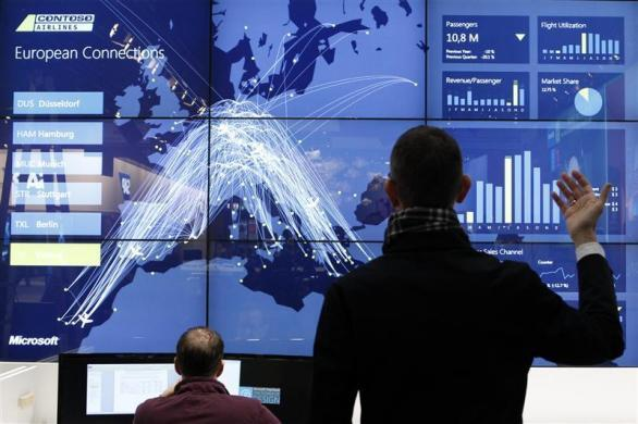 A staff member demonstrates cloud computing software to operate airlines, at the booth of Microsoft during preparations at the CeBit computer fair in Hanover, Germany March, 5, 2012.