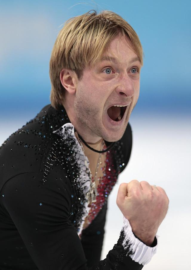 Evgeny Plyushchenko of Russia celebrates after competing in the men's team short program figure skating competition at the Iceberg Skating Palace during the 2014 Winter Olympics, Thursday, Feb. 6, 2014, in Sochi, Russia