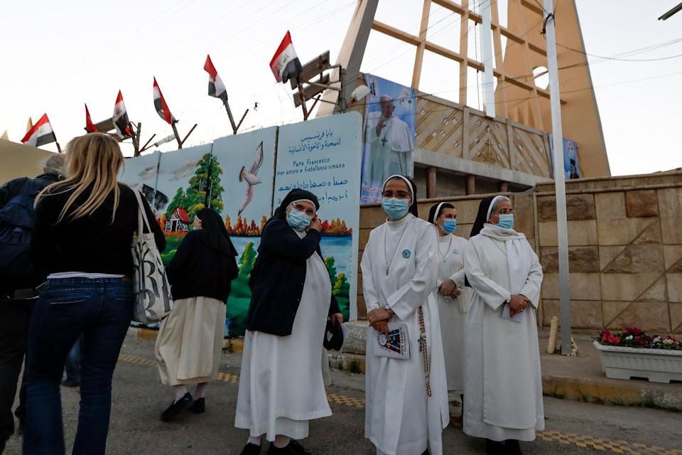 Nuns wait to see Pope Francis outside Sayidat al-Nejat (Our Lady of Salvation) church in Baghdad on FridayAP