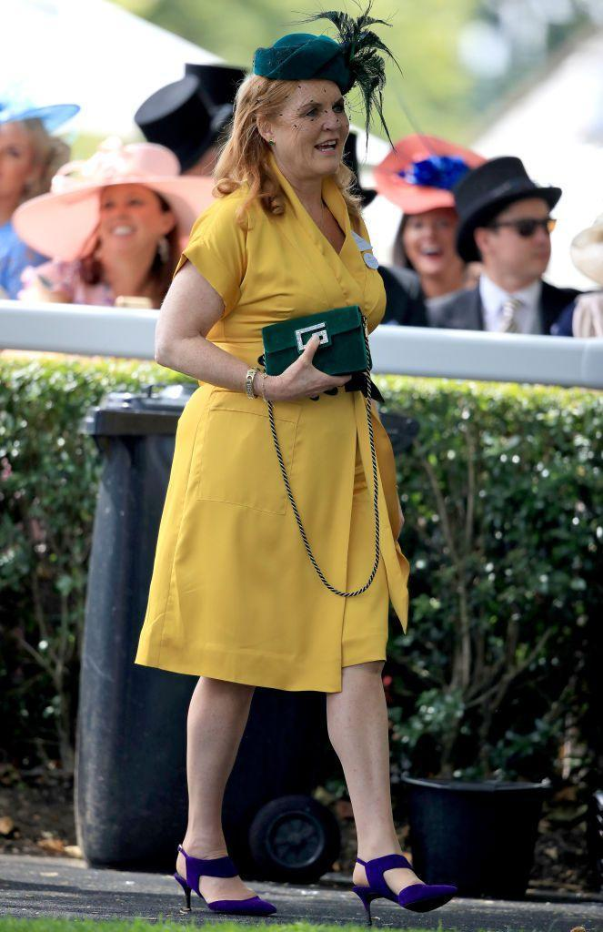 <p>Sarah Ferguson is seen at Royal Ascot wearing a vibrant yellow dress, which she paired with emerald accessories.</p>