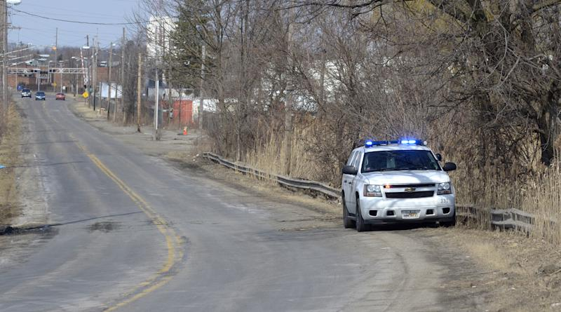 An Ohio State Patrol vehicle sits along Pine Avenue S.E. in Warren, Ohio, where police say six teens were killed in an accident where the vehicle they were traveling in went off the roadway and into a pond, Sunday, March 10, 2013. (AP Photo/Tribune Chronicle, R. Michael Semple)