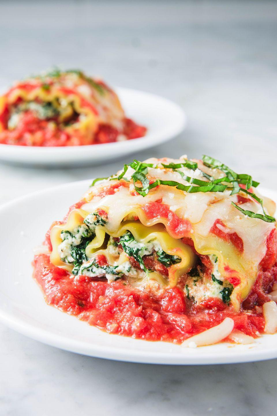 "<p>Feel free to swap in your favorite store-bought marinara. </p><p>Get the recipe from <a href=""https://www.delish.com/cooking/recipe-ideas/a24450106/spinach-lasagna-rolls-recipe/"" rel=""nofollow noopener"" target=""_blank"" data-ylk=""slk:Delish"" class=""link rapid-noclick-resp"">Delish</a>. </p>"