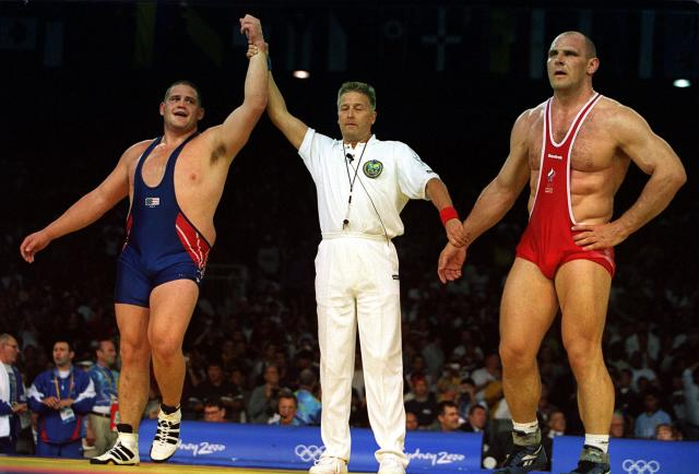27 Sep 2000: Rulon Gardner of USA (left) celebrates winning the gold medal by defeating Alexandre Kareline of Russia (right) in the 130 kilogram event during the Greco Roman wrestling held at the Sydney Convention and Exhibition Centre in Darling Harbour during the Sydney 2000 Olympic Games in Sydney, Australia. Mandatory Credit: Billy Stickland/ALLSPORT