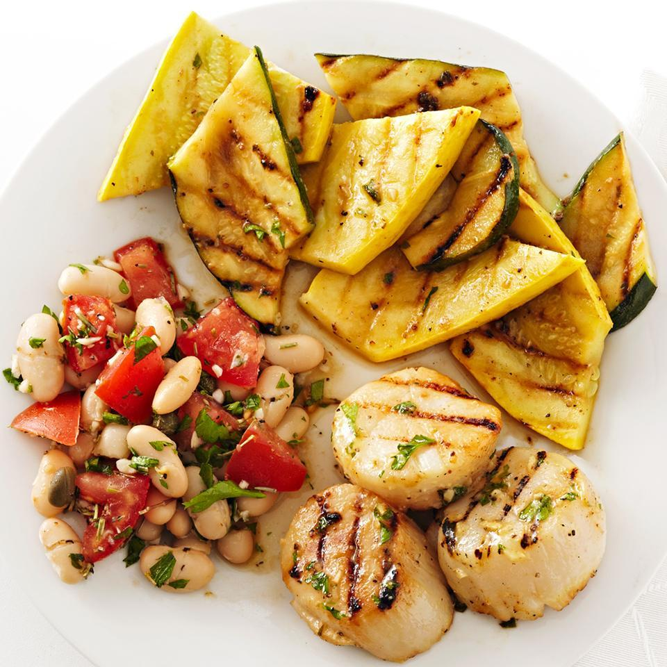<p>A simple honey-mustard dressing seasons both the squash and scallops in this quick-and-easy grilled recipe, ready in just 25 minutes.</p>