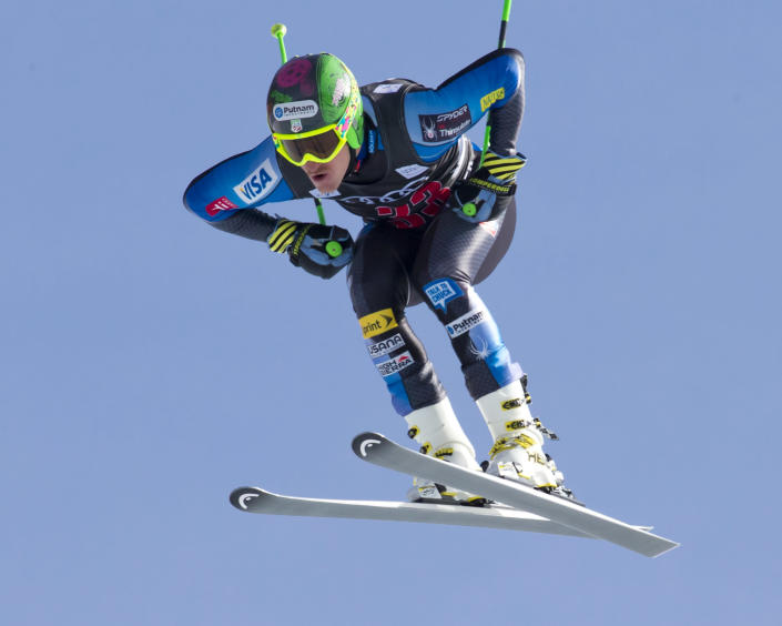 Ted Ligety of the United States, is airborne on the course during the men's World Cup downhill ski race in Beaver Creek, Colo., on Friday, Nov. 30, 2012. (AP Photo/Nathan Bilow)