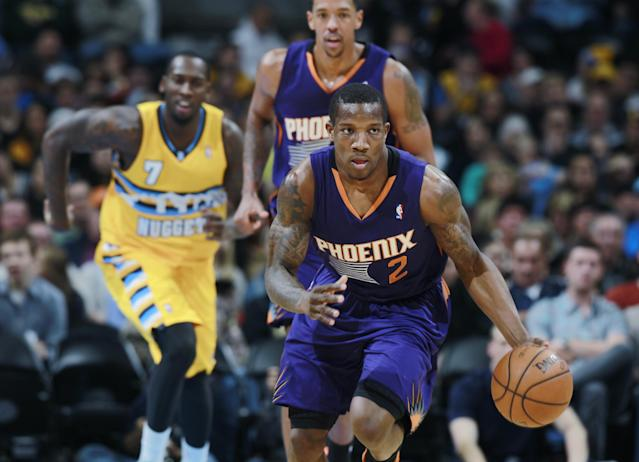 Phoenix Suns guard Eric Bledsoe, front, picks up the loose ball Denver Nuggets forward J.J. Hickson, back left, and Suns center Channing Frye follow the play in the first quarter of an NBA basketball game in Denver on Friday, Dec. 20, 2013. (AP Photo/David Zalubowski)