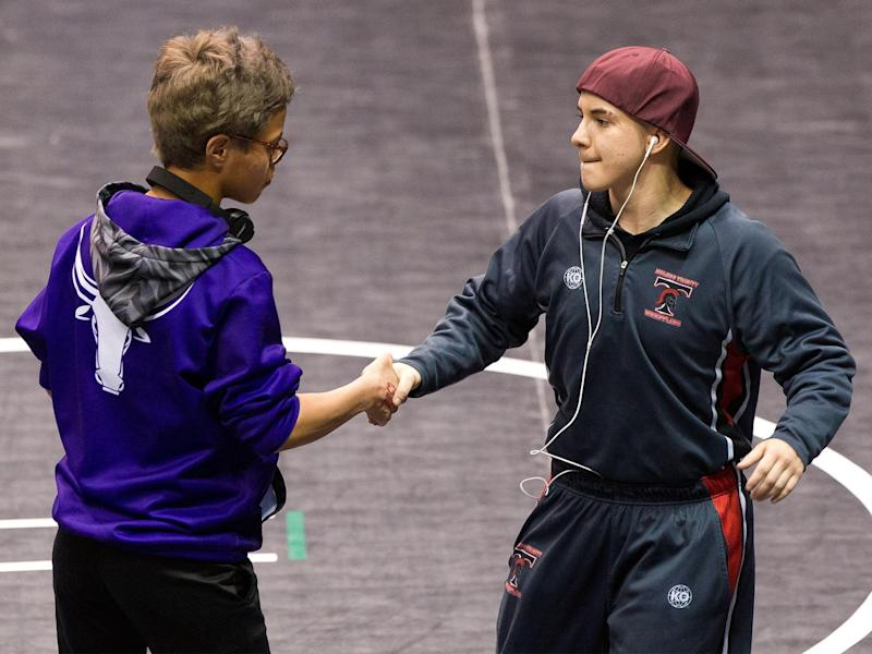 Mack Beggs (right) shakes hands with state championship final opponent Chelsea Sanchez: AP