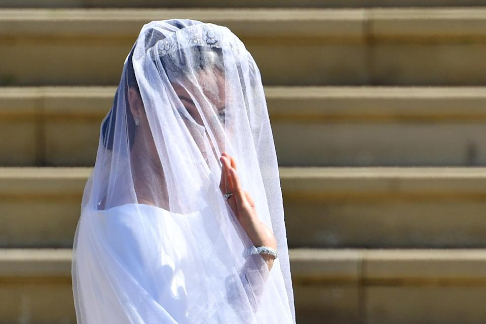 <p>U.S. actress Meghan Markle waves as she arrives for the wedding ceremony to marry Britain's Prince Harry, Duke of Sussex. BEN STANSALL/AFP/Getty Images </p>