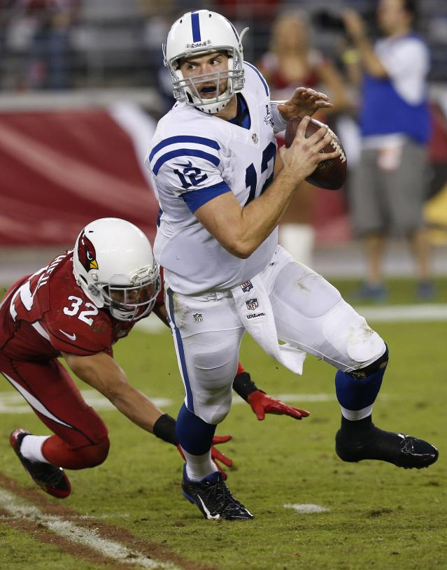 Indianapolis Colts' Andrew Luck (12) runs away from the blitz of Arizona Cardinals' Tyrann Mathieu (32) during the second half of an NFL football game Sunday, Nov. 24, 2013, in Glendale, Ariz. The Cardinals defeated the Colts 40-11. (AP Photo/Ross D. Franklin)