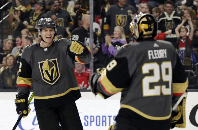 Vegas Golden Knights defenseman Nick Holden, Right, celebrates with goalie Marc-Andre Fleury after scoring against the Washington Capitals during the first period of an NHL hockey game Monday, Feb. 17, 2020, in Las Vegas. (AP Photo/Isaac Brekken)