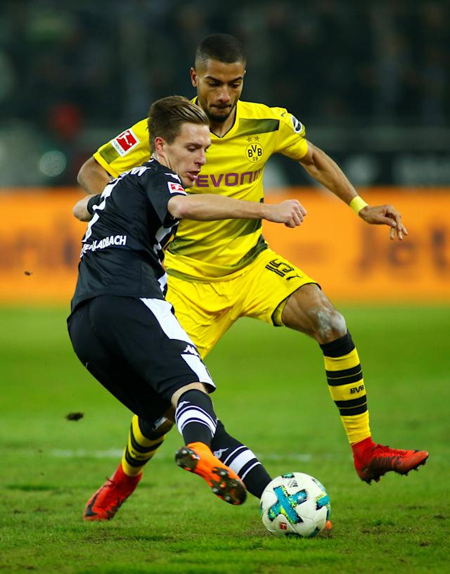 Soccer Football - Bundesliga - Borussia Moenchengladbach vs Borussia Dortmund - Borussia-Park, Moenchengladbach, Germany - February 18, 2018 Borussia Monchengladbach's Patrick Herrmann in action with Borussia Dortmund's Jeremy Toljan REUTERS/Thilo Schmuelgen DFL RULES TO LIMIT THE ONLINE USAGE DURING MATCH TIME TO 15 PICTURES PER GAME. IMAGE SEQUENCES TO SIMULATE VIDEO IS NOT ALLOWED AT ANY TIME. FOR FURTHER QUERIES PLEASE CONTACT DFL DIRECTLY AT + 49 69 650050
