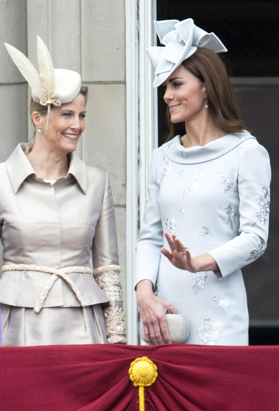 For her 2012 Buckingham Palace appearance, the Duchess of Cambridge wore a bespoke dress by Erdem with a Lock & Co fascinator. (Rex pictures)