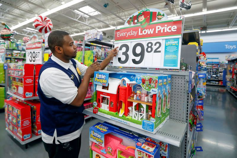 FILE PHOTO: An employee puts up a price tag ahead of Black Friday at a Walmart store in Chicago
