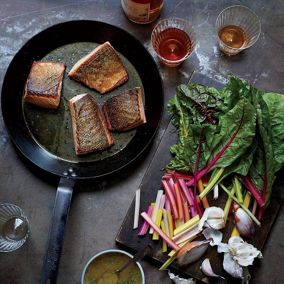 """<p>Economy is a beautiful thing: <em>Food & Wine</em> test kitchen deputy editor Justin Chapple's tarragon vinaigrette flavors both earthy chard and buttery pan-seared salmon.</p><p><a href=""""https://www.foodandwine.com/recipes/crispy-salmon-and-wilted-chard"""">GO TO RECIPE</a></p>"""