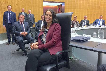 New Zealand Prime Minister Jacinda Ardern sits in a chair as she attends her first cabinet meeting since returning from maternity leave in Wellington