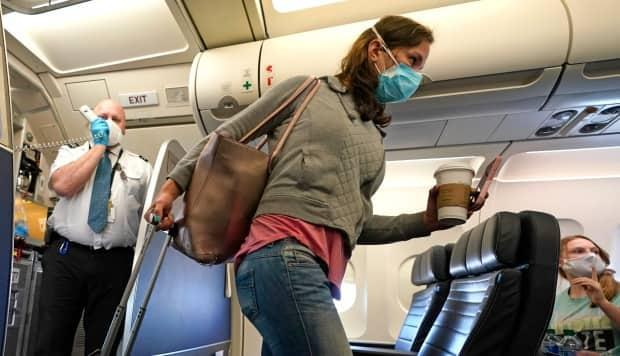 As provinces begin to ease their COVID-19 restrictions, Air Canada, WestJet and Air Transat are each offering cheap deals on domestic flights. (David J. Phillip/The Associated Press - image credit)