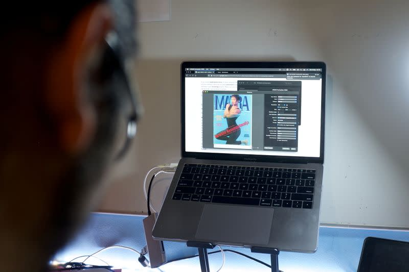 The cover of an old Indonesian LGBT+ magazine is seen on a screen while being digitised by Ais, a 29-year-old LGBT+ researcher, in Jakarta, Indonesia