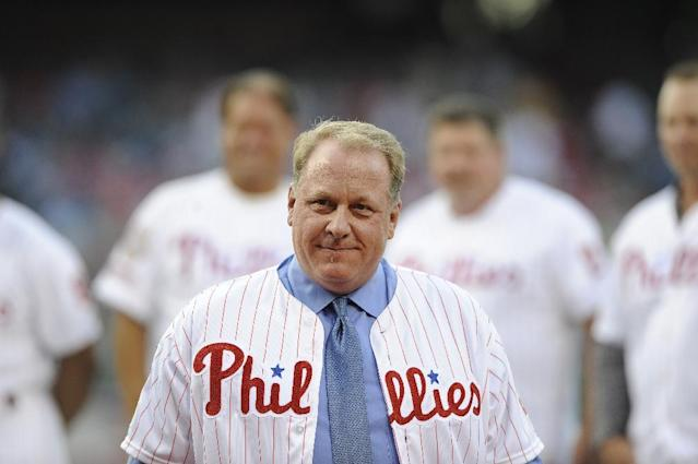 """FILE - In an Aug. 2, 2013 file photo, former Philadelphia Phillies pitcher Curt Schilling is inducted into the Phillies Wall of Fame during a baseball game between the Philadelphia Phillies and the Atlanta Braves in Philadelphia. Schilling is replacing Orel Hershiser on ESPN's """"Sunday Night Baseball"""" broadcast crew next season. In the 25th season of """"Sunday Night Baseball,"""" Schilling will join former Philadelphia teammate John Kruk, play-by-play man Dan Shulman and reporter Buster Olney. Hershiser is expected to join the Los Angeles Dodgers' new regional sports network, the Los Angeles Times reported Sunday, Dec. 8, 2013. (AP Photo/Michel Perez, File)"""