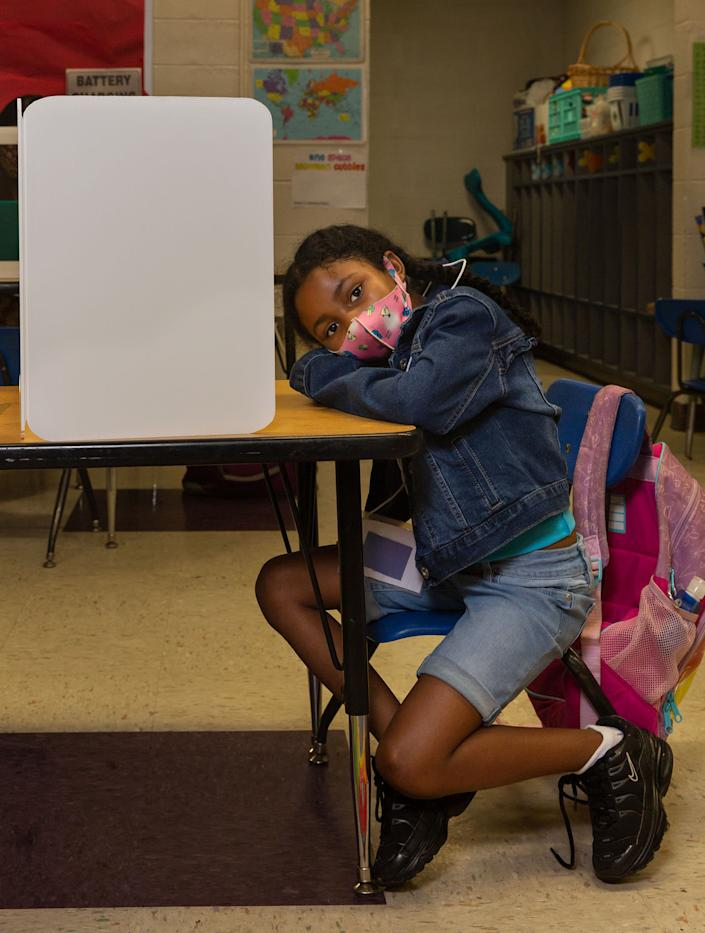 6-year-old Raziah Williams sits at her work station at Wesley Elementary | Gillian Laub for TIME