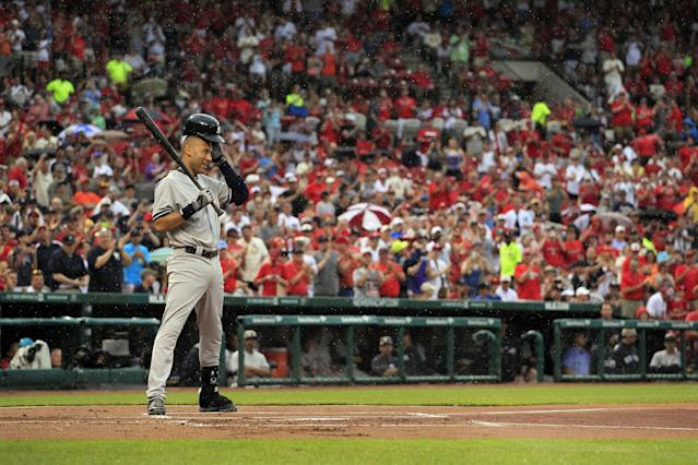 New York Yankees' Derek Jeter prepares to bat as a steady rain falls during the first inning of a baseball game against the St. Louis Cardinals Monday, May 26, 2014, in St. Louis. (AP Photo/Jeff Roberson)