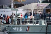 Rohingyas board a ship as they are moving to Bhasan Char island in Chattogram,