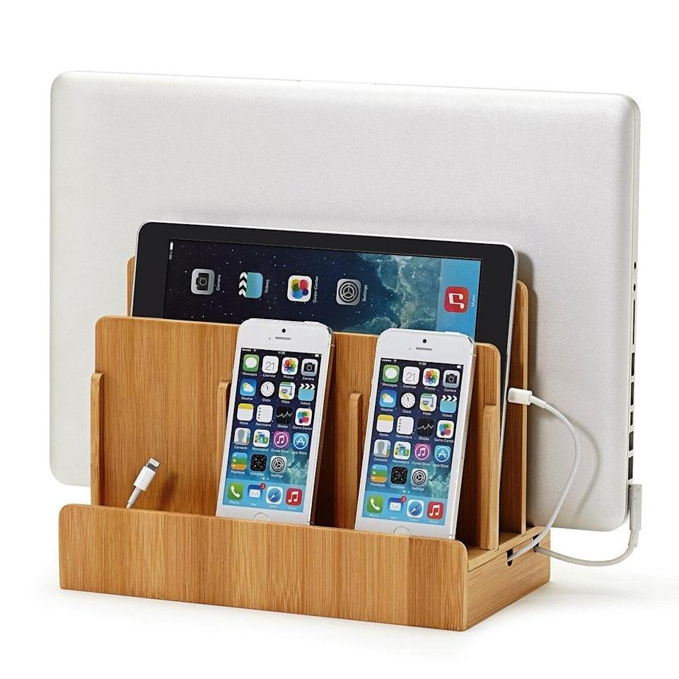 """<p>This handy <a href=""""https://www.popsugar.com/buy/Eco-Friendly-Bamboo-Multi-Device-Charging-Station-Dock-71626?p_name=Eco-Friendly%20Bamboo%20Multi-Device%20Charging%20Station%20and%20Dock&retailer=amazon.com&pid=71626&price=40&evar1=geek%3Aus&evar9=36026397&evar98=https%3A%2F%2Fwww.popsugar.com%2Ftech%2Fphoto-gallery%2F36026397%2Fimage%2F36026415%2FGUS-Eco-Friendly-Bamboo-Multi-Device-Charging-Station-Dock&list1=gifts%2Choliday%2Cgift%20guide%2Cdigital%20life%2Cfathers%20day%2Choliday%20living%2Ctech%20gifts%2Cgifts%20for%20men&prop13=api&pdata=1"""" class=""""link rapid-noclick-resp"""" rel=""""nofollow noopener"""" target=""""_blank"""" data-ylk=""""slk:Eco-Friendly Bamboo Multi-Device Charging Station and Dock"""">Eco-Friendly Bamboo Multi-Device Charging Station and Dock</a> ($40) is perfect for neatly charging and storing any electronics.</p>"""