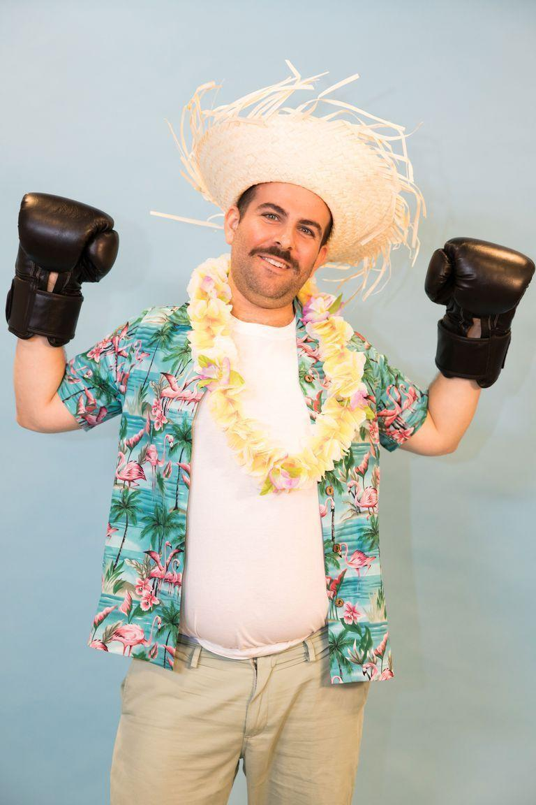 """<p>This easy costume was made for pun-lovers, and all it takes to complete the look is a Hawaiian shirt and boxing gloves.</p><p><a class=""""link rapid-noclick-resp"""" href=""""https://www.amazon.com/FightX-Practice-Lightweight-Training-Kickboxing/dp/B08V4YVYL2?tag=syn-yahoo-20&ascsubtag=%5Bartid%7C10070.g.490%5Bsrc%7Cyahoo-us"""" rel=""""nofollow noopener"""" target=""""_blank"""" data-ylk=""""slk:SHOP BOXING GLOVES"""">SHOP BOXING GLOVES</a></p>"""