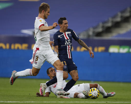 PSG's Angel Di Maria, left, tries to controls the ball as Lyon's Jason Denayer, tries to stop him, during the French League Cup soccer final match between Paris Saint Germain and Lyon at Stade de France stadium, in Saint Denis, north of Paris, Friday, July 31, 2020. (AP Photo/Francois Mori)