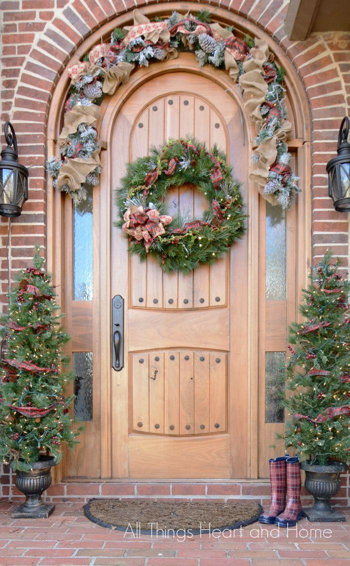 """<p>Traditionalists will love the classic, timeless look of a porch decked in pine and plaid — from wreaths to ribbons in trees to a pair of matching wellies placed jauntily alongside.<br></p><p><strong><em>Get the look at <a href=""""http://www.allthingsheartandhome.com/welcome-home-christmas-tour-2/"""" rel=""""nofollow noopener"""" target=""""_blank"""" data-ylk=""""slk:All Things Heart & Home"""" class=""""link rapid-noclick-resp"""">All Things Heart & Home</a>.</em></strong></p>"""