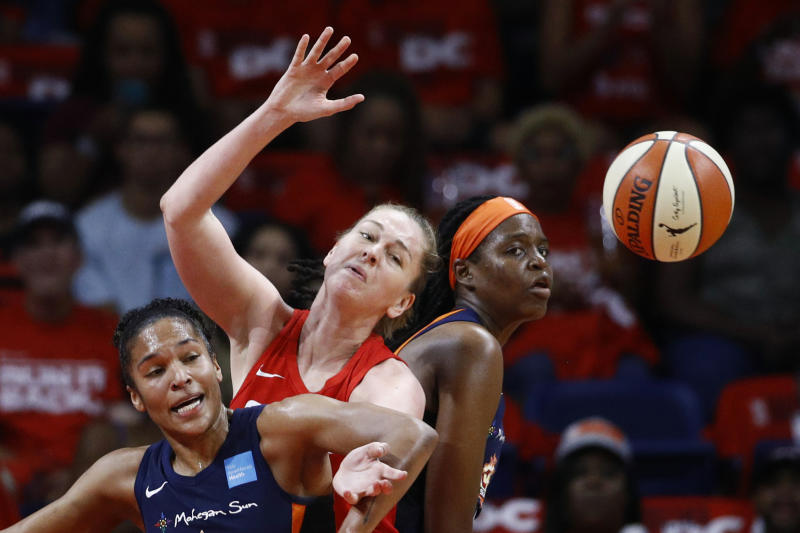 From left to right, Connecticut Sun forward Alyssa Thomas, Washington Mystics center Emma Meesseman and Sun forward Jonquel Jones become entangled while going for the ball in the first half of Game 1 of basketball's WNBA Finals, Sunday, Sept. 29, 2019, in Washington. (AP Photo/Patrick Semansky)