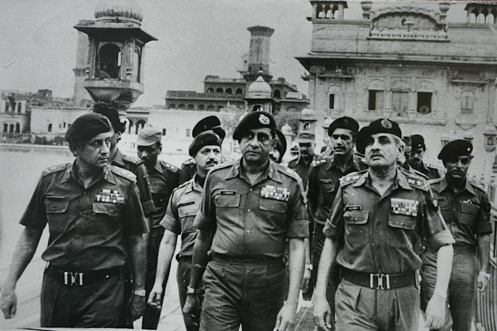 """Senior army officers at the site of a military operation ordered by Then-Prime Minister Indira Gandhi, to remove Sikh separatists in the Golden Temple in Amritsar, India, in 1984.span class=""""copyright""""The India Today Group/Getty Images/span"""