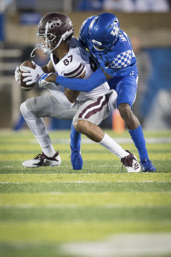 Kentucky cornerback Chris Westry (21) tackles Mississippi State wide receiver Osirus Mitchell (87) during the second half of an NCAA college football game in Lexington, Ky., Saturday, Sept. 22, 2018. (AP Photo/Bryan Woolston)