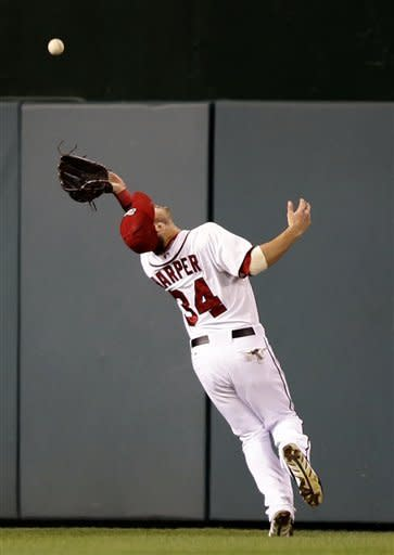 Washington Nationals center fielder Bryce Harper catches a fly hit by Los Angeles Dodgers' Shane Victorino during the fifth inning of the second baseball game of a doubleheader at Nationals Park, Wednesday, Sept. 19, 2012, in Washington. The Dodgers won the second game 7-6. (AP Photo/Alex Brandon)