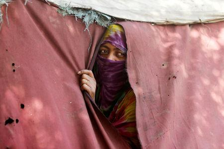 FILE PHOTO: A woman displaced from the Red Sea port city of Hodeidah looks from a tent shelter in Sanaa, Yemen November 28, 2018. Picture taken November 28, 2018. REUTERS/Mohamed al-Sayaghi/File Photo
