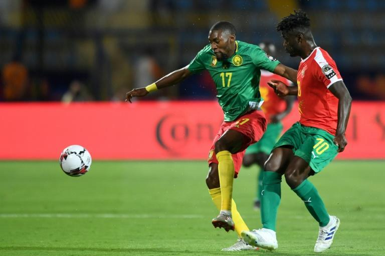 Cameroon forward Karl Toko Ekambi (L) threatens Guinea-Bissau during the 2019 Africa Cup of Nations in Egypt.
