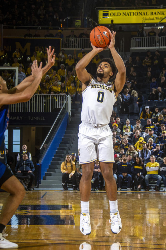 Michigan guard David DeJulius (0) takes a jumpshot in the second half of an NCAA college basketball game against Presbyterian at Crisler Center in Ann Arbor, Mich., Saturday, Dec. 21, 2019. Michigan won 86-44. (AP Photo/Tony Ding)