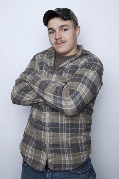 "FILE - This Jan. 2, 2013 file photo shows Shain Gandee, from MTV's ""Buckwild"" reality series in New York. Gandee was found dead Monday, April 1, in a sport utility vehicle in a ditch along with his uncle and a third, unidentified person, authorities said. Gandee died doing what made him famous: careening through huge mudholes in his SUV, taking chances most others won't, living free and reckless in front of reality-show TV cameras. His death further blurs the line between entertainment and real life in an age where fame is easier than ever to attain. (Photo by Amy Sussman/Invision/AP, file)"