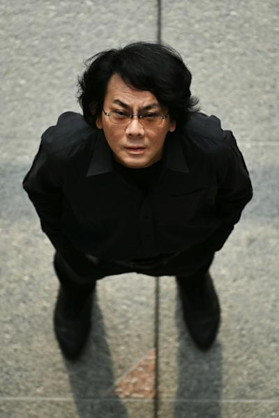 Japanese roboticist Hiroshi Ishiguro believes recent breakthroughs in robotics and artificial intelligence will accelerate the synthesis of man and machine (AFP Photo/CHARLY TRIBALLEAU)