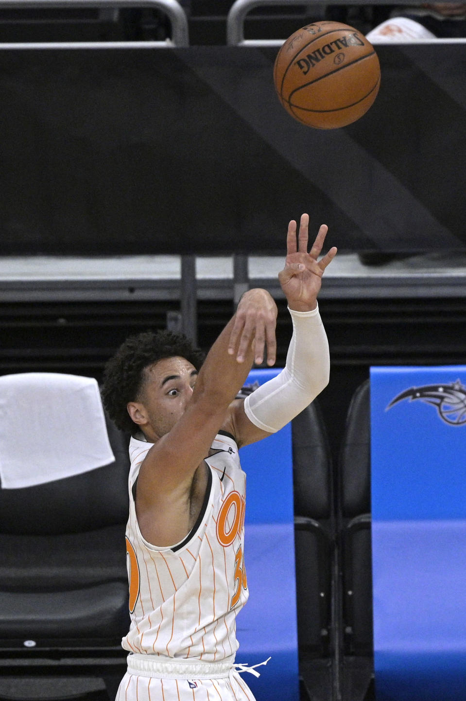 Orlando Magic guard Devin Cannady attempts a 3-point shot during the second half of the team's NBA basketball game against the New Orleans Pelicans, Thursday, April 22, 2021, in Orlando, Fla. (AP Photo/Phelan M. Ebenhack)