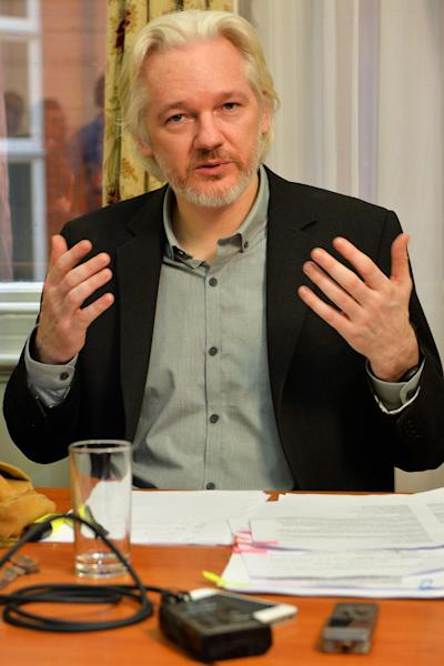 Julian Assange speaks during a press conference inside the Ecuadorian Embassy in London on August 18, 2014 where the WikiLeaks founder has been holed up for two years (AFP Photo/John Stillwell)