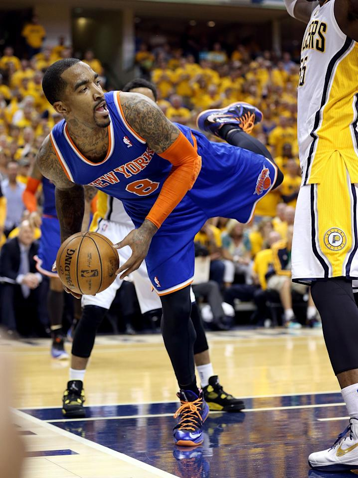 INDIANAPOLIS, IN - MAY 18: J.R. Smith #8 of the New York Knicks looks to pass the ball during the game against the Indiana Pacers during Game Six of the Eastern Conference Semifinals of the 2013 NBA Playoffs at Bankers Life Fieldhouse on May 18, 2013 in Indianapolis, Indiana. NOTE TO USER: User expressly acknowledges and agrees that, by downloading and or using this photograph, User is consenting to the terms and conditions of the Getty Images License Agreement.  (Photo by Andy Lyons/Getty Images)